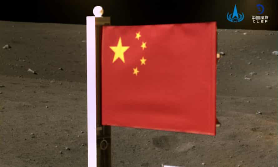 China's national flag is seen unfurled on the moon from the Chang'e-5 spacecraft.