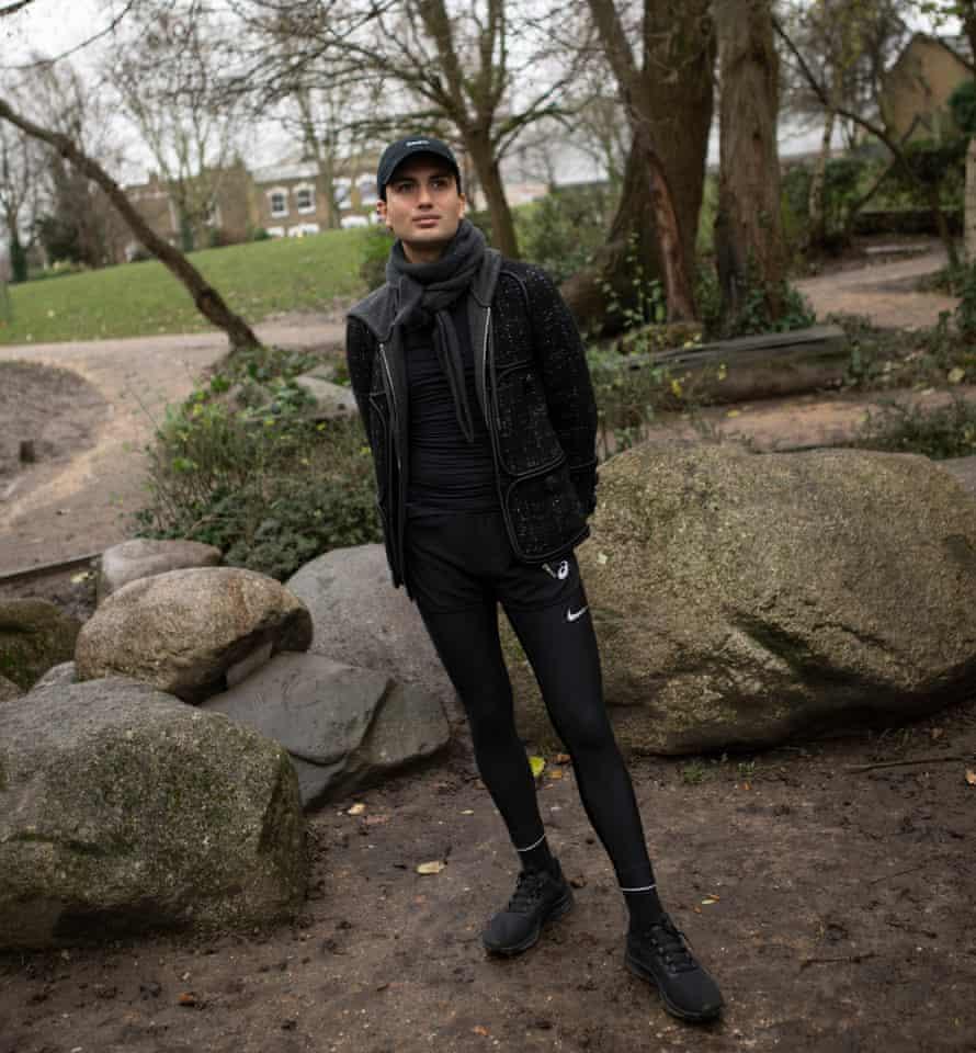 Osman Ahmed wearing black athleisure
