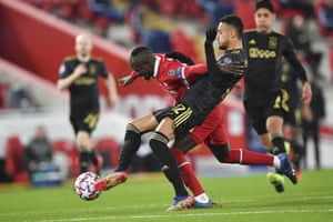 Liverpool's Sadio Mane is tackled cleanly by Ajax's Noussair Mazraoui.