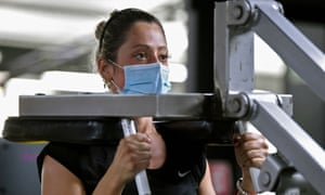 A woman wears a face mask while exercising at a gyms in Mexico City last month.