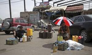 Dealers wait for customers to buy black market fuel amid an acute shortage of fuel in Sanaa, Yemen.