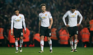 Jesse Lingard, Michael Carrick and Chris Smalling walk off the pitch dejected after defeat.