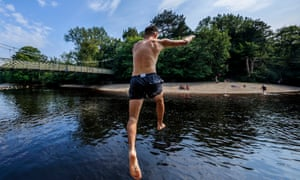 A swimmer jumps into the River Wharfe in Yorkshire