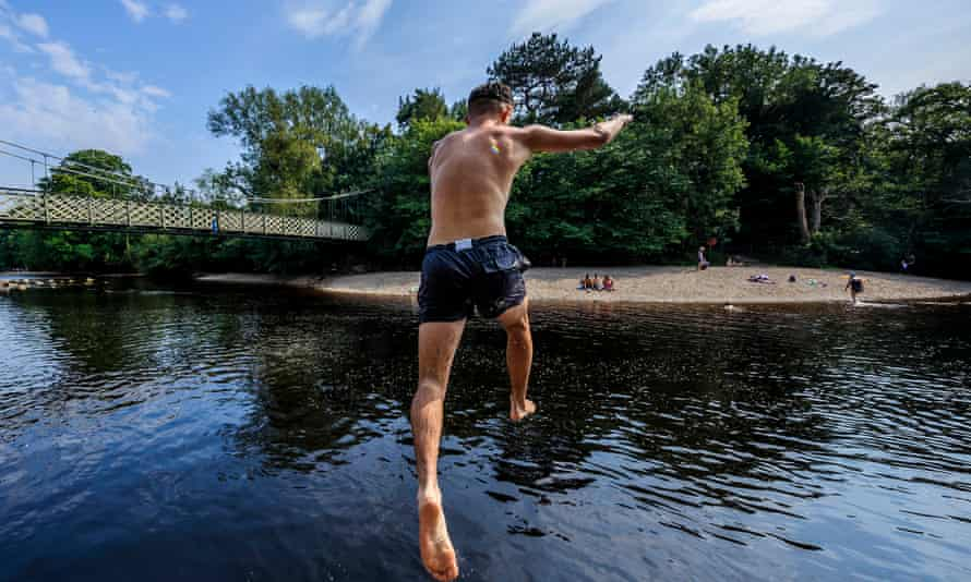 A person jumps into the River Wharfe