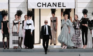 Karl Lagerfeld acknowledges the audience at the Chanel spring/summer 2009 show in Paris.