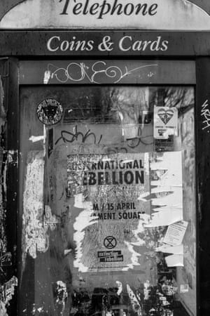 A phone box in Finsbury Park, north London, with an old Extinction Rebellion poster
