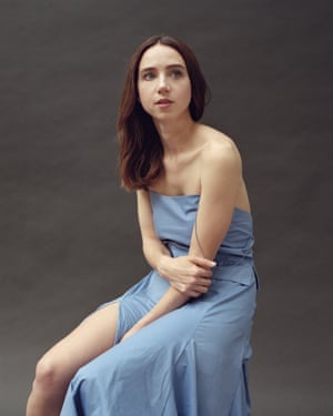 Zoe Kazan  in a blue top and skirt