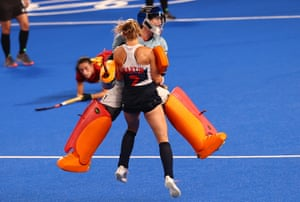 Hannah Martin and Madeleine Hinch of Britain celebrate after winning their hockey shoot-out versus Spain.
