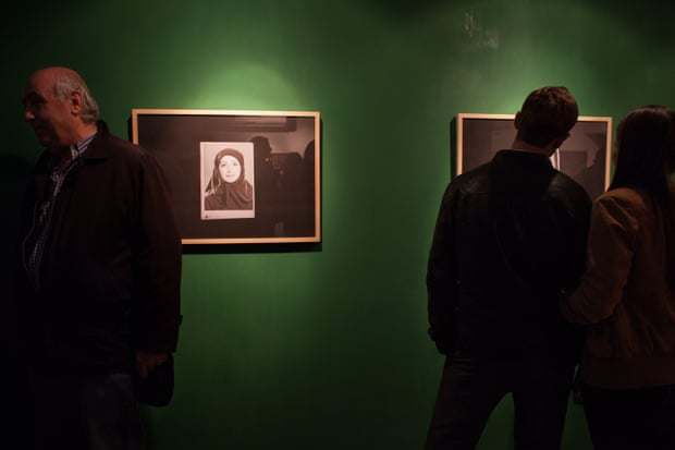 Attendees look at photographs by Itay Davidyan at the opening of the Iranian embassy of culture in Jerusalem on 21 December 2015.