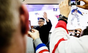 A Kim Jong-un impersonator, known only as Howard, poses for photos with patrons in Holland House in Gangneung, South Korea.