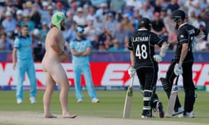 A streaker chats to the New Zealand batsmen during the match against at the Riverside Ground.
