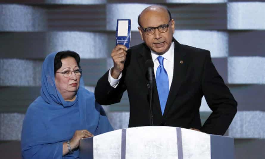 Khizr Khan, father of fallen US army captain Humayun Khan holds up a copy of the constitution as his wife listens at the 2016 Democratic national convention in Philadelphia.