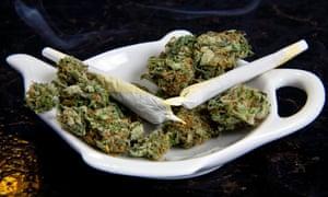 Marijuana joint cigarette and marijuana buds in fancy dish