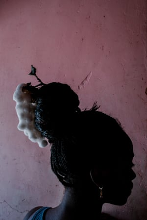 Johis Alarcón, Ecuador Nicole Carcelén, 19, plays with a cotton plant in her hair. The black slaves who first came to Ecuador were forced to work in cotton fields, cane fields and coal mines. For Nicole, cotton plants represent the strength of her ancestors and the strength of their blood. La Loma, 2018