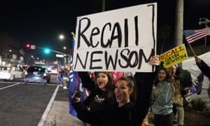 Demonstrators call for Gavin Newsom's recall in Huntington Beach, California, on 21 November.