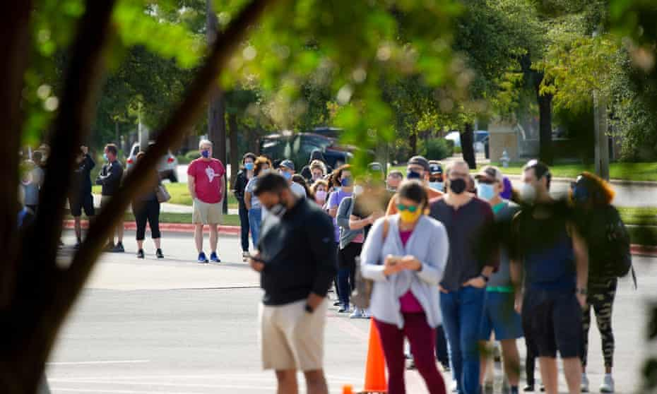 Hundreds of voters wait in line to cast their vote during early voting in Austin, Texas, on 16 October.