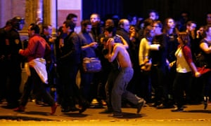 Wounded people are evacuated outside the Bataclan concert hall.