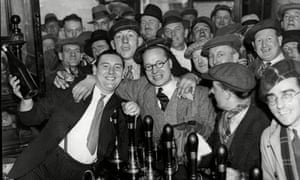 Alex Jackson in the pub he managed, the Angel & Crown Inn on St Martin's Lane, in 1934.