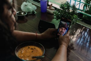 Esperanza Pacheco sharing the meal by video call with her husband. León, México. June 11,2020.