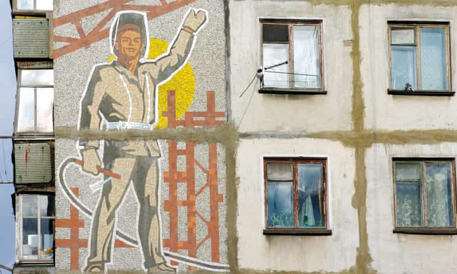 A Soviet era mosaic of a worker on the side of an apartment block in Yuzhno Sakhalinsk, eastern Russia.