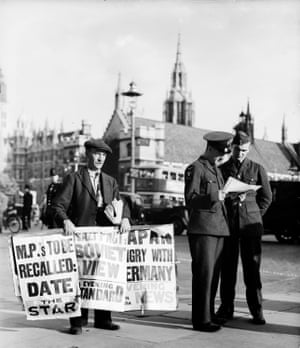 Newspaper sellers in Parliament Square publicise the news of a non-aggression pact between Nazi Germany and the USSR, 22 August 1939.
