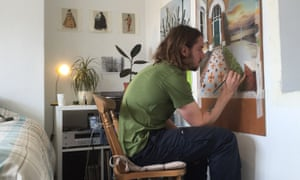 Student Sam Creasey painting in a shared flat in London