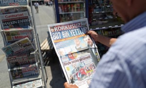 A man reads a newspaper announcing İmamoğlu's victory in Istanbul