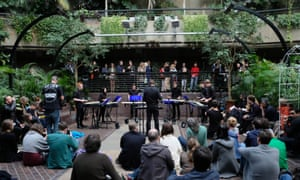 A performance of Michael Gordon's Timber: Music for Planks of Wood in the Barbican's Conservatory