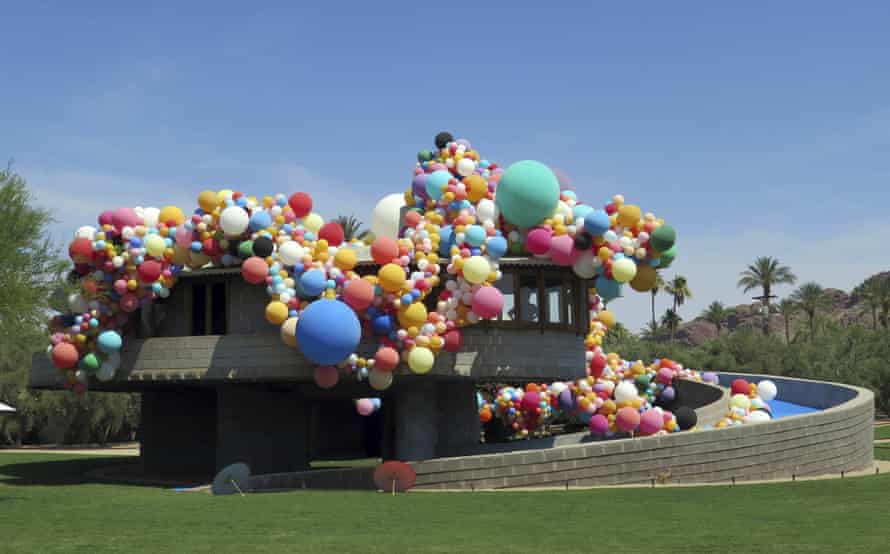 The spiral home covered in balloons.