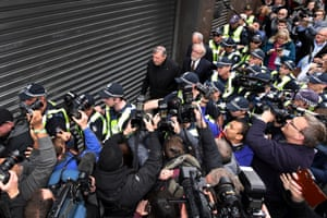 Members of the media surround Pell