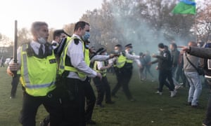 Police and protesters clash after the protest at Hyde Park in London yesterday.