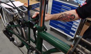 A green Brompton bike assembled the production line in west London.