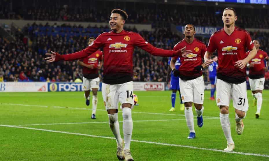 Jesse Lingard celebrates with Nemanja Matic after scoring Manchester United's fourth goal against Cardiff.