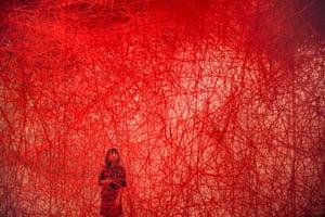 Tokyo, Japan: A woman looks at Uncertain Journey, Chiharu Shiota's installation, at the Mori Art Museum