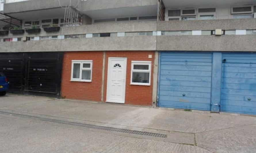 Exterior view of the converted one-bedroom garage flat sitting in a line of garages