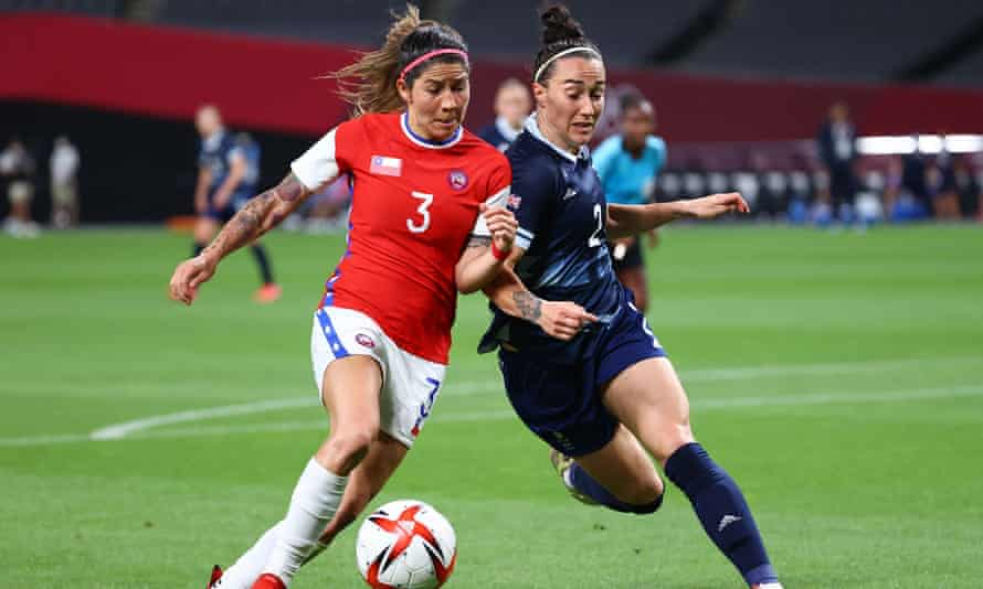 Lucy Bronze (right) battles with Chile's Carla Guerrero during Team GB's victory in their opening match at the Tokyo Olympics.