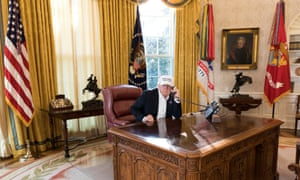 Donald Trump is seen in the Oval Office, in a White House handout picture.