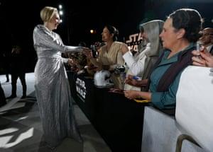 Actress Gwendoline Christie greets fans.