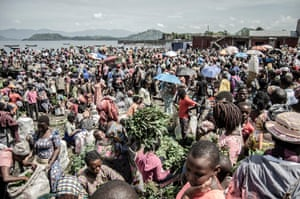 Vendors and shoppers at a market on the shores of Lake Kivu in Goma, eastern DRC, 2 April 2020.
