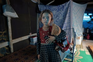 Atme, Syria: Rawan al-Aziz, a displaced 6-year-old child from southern Idlib, poses for a picture in a tent at the camp near the Turkish border
