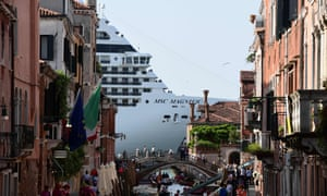 MSC Magnifica is seen from one of the canals leading into the Venice Lagoon in Venice