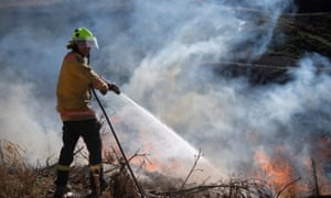 A firefighter puts out a blaze during a week-long wildfire on New Zealand's South Island.