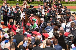 Michelle Payne brings Prince of Penzance through the crowds after winning.