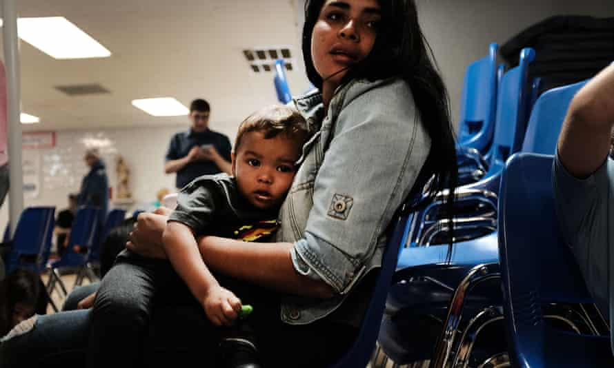 A woman with her son at the border. Advocacy groups had been warning for months that family separations were already taking place.