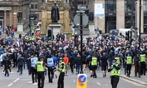 Police officers move in to position in central Glasgow to form a barrier between opposing groups on June 14, 2020, as people gather to 'defend' a statue of former Conservative prime minister and Metropolitan Police founder Robert Peel from those calling for it's removal.