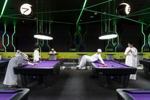 Young Emirati men playing a game of pool at Hub Zero, an immersive entertainment hub located at City Walk shopping mall.