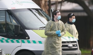 Medical staff prepare to transport people from the St Basil's aged care home in Fawkner, Melbourne, which has had an outbreak of coronavirus. On Sunday Victoria reported 10 Covid-19 deaths and 459 new cases.