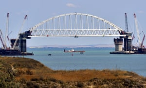 The railway arch being lifted into place over the Kerch Strait