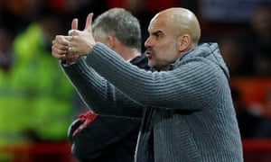 Manchester City manager Pep Guardiola gestures during the match.