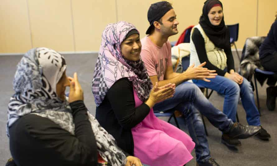 Refugees being given an English lesson by the FaithAction charity in London, December 2015.